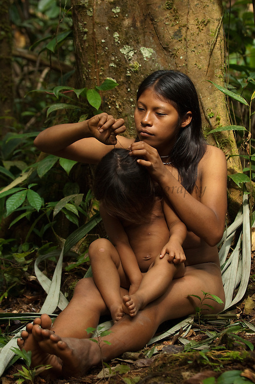 Huaorani Indian girls - Carmen Kaiga &amp; Romelia Andy. Gabaro Community. Yasuni National Park.<br /> Amazon rainforest, ECUADOR.  South America<br /> This Indian tribe were basically uncontacted until 1956 when missionaries from the Summer Institute of Linguistics made contact with them. However there are still some groups from the tribe that remain uncontacted.  They are known as the Tagaeri. Traditionally these Indians were very hostile and killed many people who tried to enter into their territory. Their territory is in the Yasuni National Park which is now also being exploited for oil.