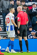 Florin Andone (Brighton) talking with Lee Mason (Referee) during the FA Cup fourth round match between Brighton and Hove Albion and West Bromwich Albion at the American Express Community Stadium, Brighton and Hove, England on 26 January 2019.