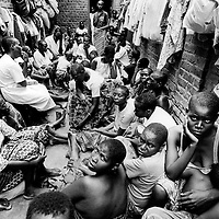 Kigali prison, Rwanda. 20th March 1995. Nearly 8,000 prisoners in a prison built for 2000 - of those 260 are women accused of participation in the genocide, 194 are children, some detainees.