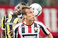 TILBURG - Willem II - Vitesse , Voetbal , Seizoen 2015/2016 , Eredivisie , Koning Willem II Stadion , 09-08-2015 , Willem II speler Stijn Wuytens (r) en Vitesse speler Marvelous Nakamba (l) in kopduel
