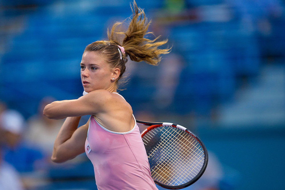 August 21, 2014, New Haven, CT:<br /> Camila Giorgi hits a backhand during a match against Garbine Muguruza on day seven of the 2014 Connecticut Open at the Yale University Tennis Center in New Haven, Connecticut Thursday, August 21, 2014.<br /> (Photo by Billie Weiss/Connecticut Open)