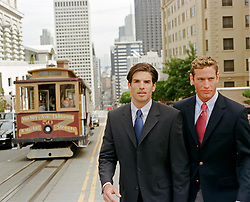 two men walking in San Francisco by the trolley