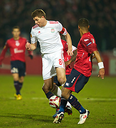 LILLE, FRANCE - Thursday, March 11, 2010: Liverpool's captain Steven Gerrard MBE in action against LOSC Lille Metropole during the UEFA Europa League Round of 16 1st Leg match at the Stadium Lille-Metropole. (Photo by David Rawcliffe/Propaganda)