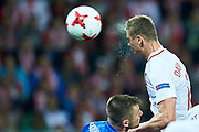 Lublin, Poland - 2017 June 16: Pawel Dawidowicz from Poland U-21 shoots on the goal while Poland v Slovakia match during 2017 UEFA European Under-21 Championship at Lublin Arena on June 16, 2017 in Lublin, Poland.<br /> <br /> Mandatory credit:<br /> Photo by &copy; Adam Nurkiewicz / Mediasport<br /> <br /> Adam Nurkiewicz declares that he has no rights to the image of people at the photographs of his authorship.<br /> <br /> Picture also available in RAW (NEF) or TIFF format on special request.<br /> <br /> Any editorial, commercial or promotional use requires written permission from the author of image.