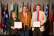 Adair native Thomas Neal (right), an animal science major, receives an Oklahoma State University Win and Kay Ingersoll Scholarship from Win and Kay Ingersoll (left) at the university's recent College of Agricultural Sciences and Natural Resources Scholarships and Awards Banquet. The scholarship is part of more than $1.4 million in scholarships and awards presented to CASNR students for the 2016-2017 academic year. (Photo by Todd Johnson)