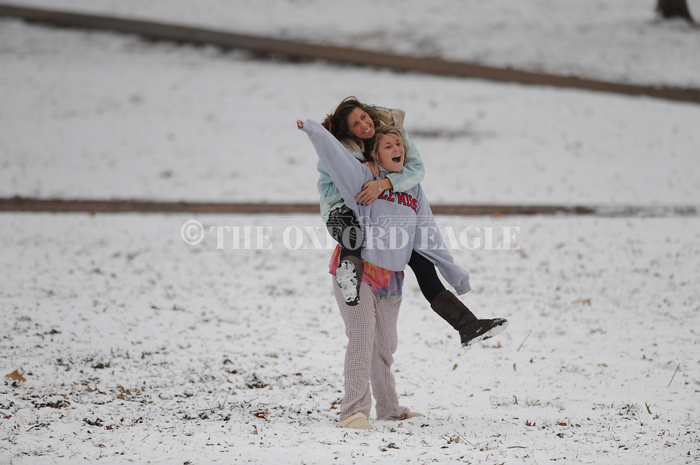 Ole Miss students Katie Hughes (left) and Cara Horn in the snow in the Grove on Thursday, January 7, 2010