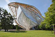 Glass sails of the Fondation Louis Vuitton, an art museum and cultural centre designed by Frank Gehry, b. 1929, and built 2008-14, next to the Jardin d'Acclimatation in the Bois de Boulogne, in the 16th arrondissement of Paris, France. The building resembles the sails of a boat and houses 11 galleries, an auditorium seating 350 and roof terraces. Picture by Manuel Cohen
