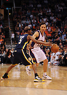 Mar. 6 2010; Phoenix, AZ, USA; Phoenix Suns guard Steve Nash (13) dribbles the ball against Indiana Pacers guard T.J. Ford (5) in the second half at the US Airways Center. The Suns defeated the Pacers 113 to 105. Mandatory Credit: Jennifer Stewart-US PRESSWIRE.