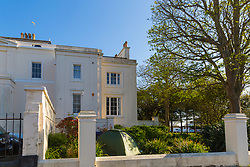 Beach House in East Sussex has two tents pitched in the adjacent grounds, evidently belonging to homeless people, who have been served notice by the local council to move out of the area.. Worthing, East Sussex, April 29 2019.