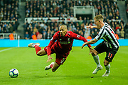 Fabinho (#3) of Liverpool is fouled by Matt Ritchie (#11) of Newcastle United leading to Divock Origi (#27) of Liverpool scoring the winning goal for Liverpool from the resulting free kick during the Premier League match between Newcastle United and Liverpool at St. James's Park, Newcastle, England on 4 May 2019.