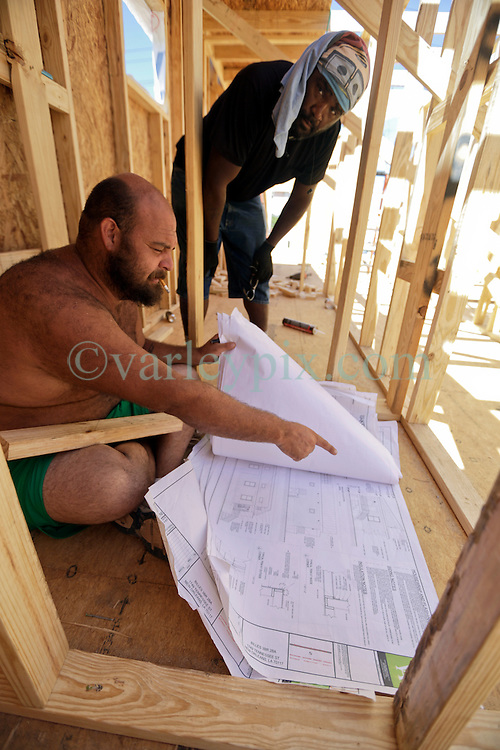 26 August 2015. New Orleans, Louisiana. <br /> Hurricane Katrina revisited. <br /> Rebuilding the Lower 9th Ward. <br /> Site foreman Daniel Reyes oversees the first phase of construction for another eco friendly 'Make it Right' house on Tennessee Street.  'Make it Right' homes inspired by actor Brad Pitt continue to provide hope for the rebirth of the community following the devastation of hurricane Katrina a decade earlier.<br /> Photo credit&copy;; Charlie Varley/varleypix.com.
