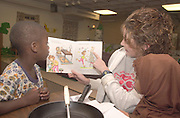 Ashely Ollam, Kids on Campus staff, Reads to Nkrumah Oheneba(left), Athens and Zakiya Abinoor, Athens