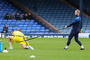 AFC Wimbledon fitness coach Jason Moriarty helping AFC Wimbledon attacker Marcus Forss (15) stretch during the EFL Sky Bet League 1 match between Southend United and AFC Wimbledon at Roots Hall, Southend, England on 12 October 2019.