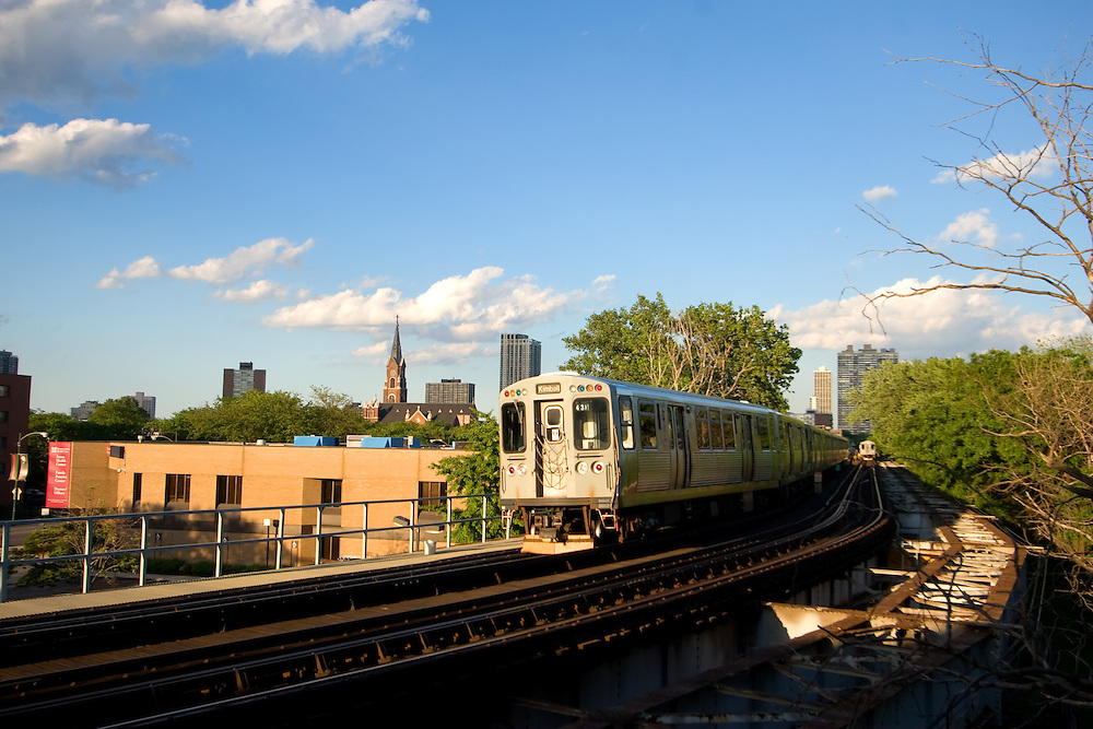 Squealing around a tight curve, a Brown Line L train makes its way through the neighborhoods of the north side of Chicago, IL.