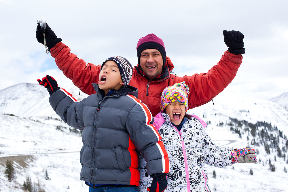 Javier Chung's family  enjoying the fresh winter snow on Cottonwood Pass near Buena Visata, Colorado.