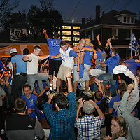 March 31, 2012 - Lexington, Kentucky, USA - University of Kentucky basketball fans stand on cars as they celebrate their team's victory over the University of Louisville in Lexington, Ky., on March 31, 2012. The win for Kentucky advances them to the championship game of the NCAA tournament in New Orleans. Fans took to the streets and in burned couches, turned over a car and ending with a handful of arrests. (Credit image: © David Stephenson/ZUMA Press)