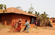 EXCLUSIVE PICTURE FEATURE<br /> The Living Ghosts of Benin<br /> <br /> *Villagers believe if they are touched by an Egungun, they will die<br /> <br /> *Having any contact whatsoever with an Egungun can prove deadly for both the Egungun and the other person, so each Egungun is accompanied by a 'minder', also a member of the Egungun society, who carries a long and substantial stick to drive individuals away...<br /> <br /> <br /> <br /> BENIN is a small country sandwiched between Nigeria to the East and Ghana and Togo to the West. Formerly a French colony known as Dahomey, little is known about the country prior to around the 15th century when it was occupied first by the Portuguese, then the British, Dutch and lastly French who ousted King Behanzin and took control in 1894. <br /> <br /> The Egungun are one of Benin&rsquo;s Secret Societies who appear as masked men representing the spirits of the Living Dead. They are Living Ghosts, a conduit to the ancestors. Their role in village society is to settle local disputes, and their knowledge is often consulted in times of trouble within their village. The Egungun speak in a high-pitched and altogether un-human and unsettling falsetto tone, similar to the voices used in a Punch-and-Judy show, and in a language that is not understood by other villagers; they are always accompanied by drummers. Some say they derive their name from the Yoruba (Northern Nigerian) word for &quot;bones&quot; or &quot;skeleton,&quot; but in Yoruba, Egungun also means &quot;masquerade.&rdquo;  Egungun arrive in villages, pass judgements and give advice. Their word is final as their advice is a direct word of the Gods.<br /> <br /> Each Egungun appears as a robed figure - giving the impression that the deceased is making a temporary reappearance on Earth. This impression is enhanced by the voluminous costumes of the Egungun; the cloth and design they use expresses the power of the ancestor. In one village I came across an Egungun with the stature and form of a child. I enquired as to his age (all Egungun are male). As soon as I&rsquo;d asked I realised that