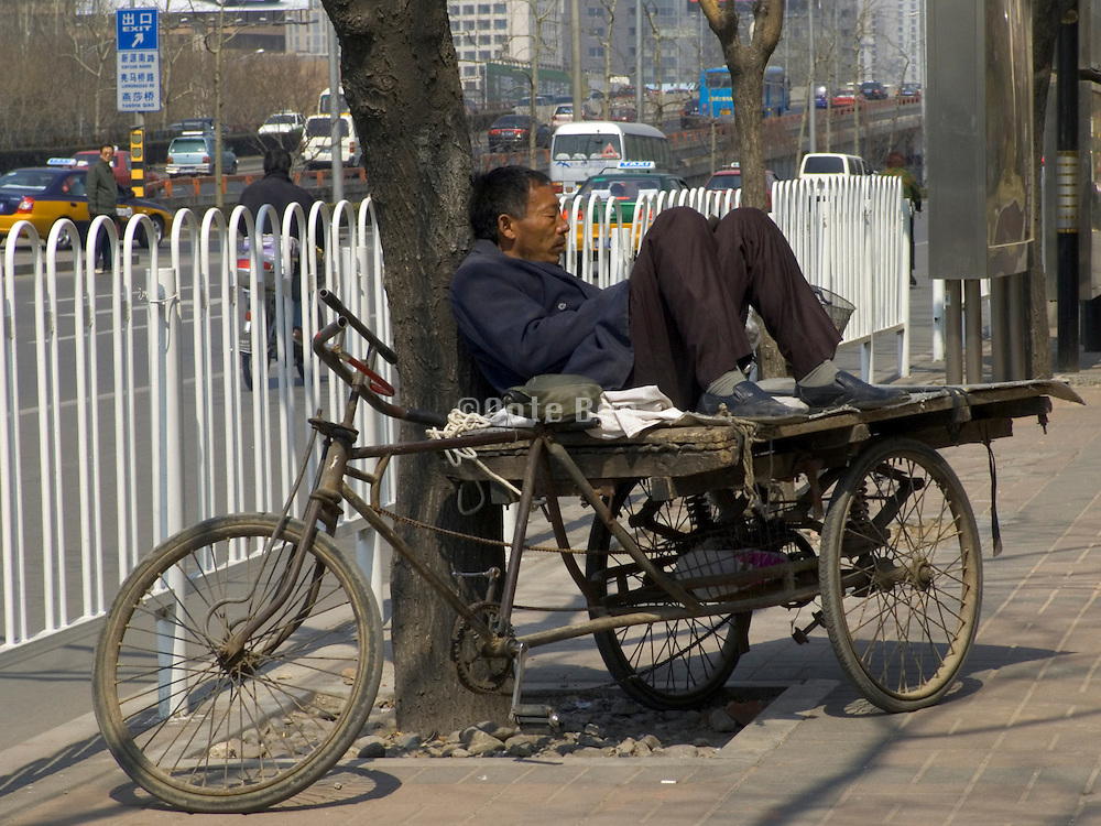 man taking a nap while waiting for a job China Beijing