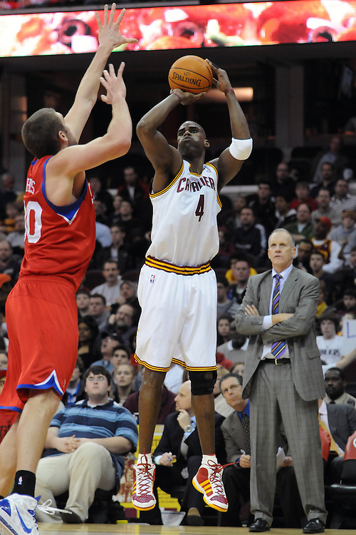 Feb. 27, 2011; Cleveland, OH, USA; Cleveland Cavaliers power forward Antawn Jamison (4) shoots over Philadelphia 76ers center Spencer Hawes (00) during the third quarter at Quicken Loans Arena. The 76ers beat the Cavaliers 95-91.Mandatory Credit: Jason Miller-US PRESSWIRE