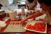 "Lenotre Ecole Culinaire, Paris,..short course - ""Return to the Market"" with Chef Jacky Legras.working with tomatoes for the confite...photo by Owen Franken for the NY Times..July 12, 2007......."