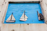 Handmade driftwood boats decorate a wall in the tiny village of Hope Town, Elbow Cay Abacos, Bahamas.