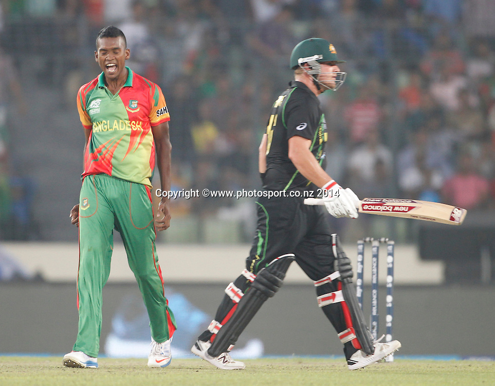 Al Amin Hossain celebrates getting David Warner out - Bangladesh v Australia, Shere Bangla National Stadium, Mirpur, Bangladesh. 1 April 2014. Photo: www.photosport.co.nz