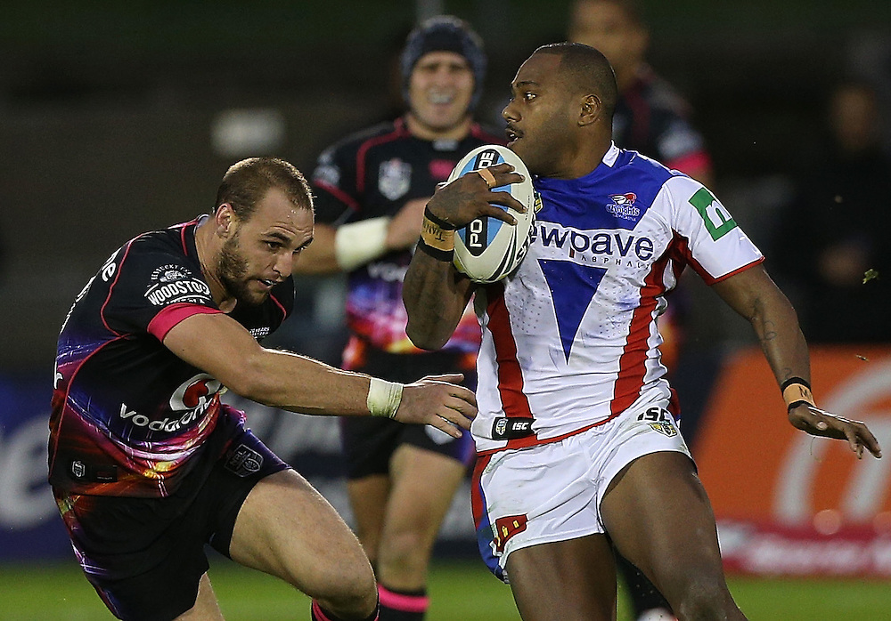 Captain Simon Mannering of the New Zealand Warriors tackles Akuila Uate of the Newcastle Knights during their round 12 NRL match at Mount Smart Stadium, Auckland on  Sunday, May 31, 2015. Credit: SNPA / David Rowland