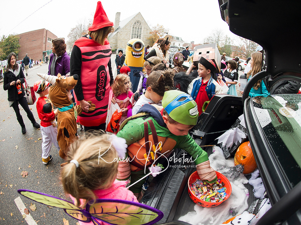 "Mrs. Perry and her pre Kindergarten students go ""trick or trunking"" in Meredith Kelley's trunk during Holy Trinity's Halloween parade Thursday afternoon.  (Karen Bobotas/for the Laconia Daily Sun)"