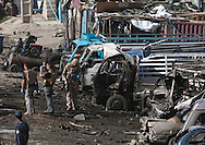 British soldiers survey the site of a bomb blast in Kabul August 18, 2009. Seven people were killed and 52 wounded by a suicide car bomber who rammed his car into a convoy of Western troops in the Afghan capital on Tuesday, said Farid Raeed an official at the public health ministry. The strike, on the road heading east out of the capital toward the city of Jalalabad, comes two days before a tense presidential election. Photo by Keith Bedford
