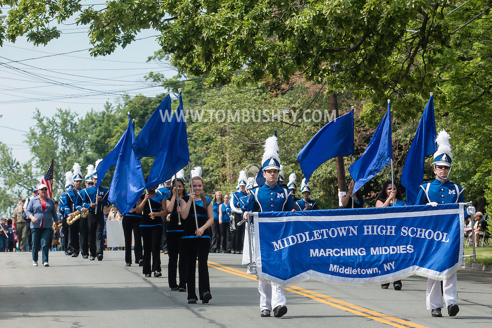 Middletown, New York - Marchers in the Middletown-Town of Wallkill Memorial Day parade head down Highland Avenue on May 25, 2015.