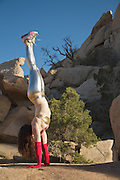 Hagar practices handstand at Joshua Tree National Park