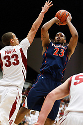 November 18, 2010; Stanford, CA, USA;  Virginia Cavaliers forward Mike Scott (23) shoots over Stanford Cardinal forward Dwight Powell (33) during the first half at Maples Pavilion.