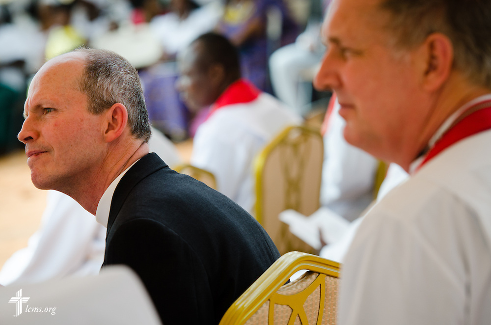 The Rev. Robert Roethemeyer listens during the service and dedication of the Lutheran Theological Seminary of the Evangelical Lutheran Church of Ghana on Sunday, Feb. 2, 2014, in Greater Accra, Ghana. In front is the Rev. Dr. David Erber. LCMS Communications/Erik M. Lunsford