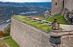 Sited on a 1200-foot-high bluff above the Elbe River in Saxony, Germany, the Konigstein Fortress traces its roots to a medieval castle built in the 13th century.  Note river cruise ship,  center left edge.