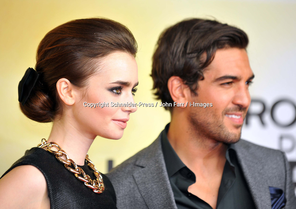 Lily Collins and Elyas M'Barek  arrives for the 'The Mortal Instruments: City of Bones' Germany premiere at Sony Centre on Tuesday August 20, 2013 in Berlin, Germany. Photo by Schneider-Press / John Farr / i-Images. <br /> UK &amp; USA ONLY