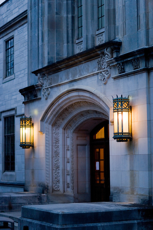 Front door of old building on a college campus in Arkansas at dusk.