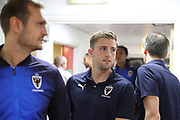 AFC Wimbledon defender Ben Purrington (3) and AFC Wimbledon striker James Hanson (18) arriving during the EFL Trophy match between Charlton Athletic and AFC Wimbledon at The Valley, London, England on 4 September 2018.
