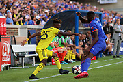 Harrison Afful #25 of the Columbus Crew moves the ball past Roland Lamah #7 of FC Cincinnati during a MLS soccer game, Sunday, Aug 25th, 2019, in Cincinnati, OH. (Jason Whitman/Image of Sport)