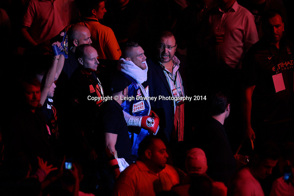 Christopher Rebrasse walks through the crowd to the ring ahead of his fight against George Groves for the EBU (European) Super Middleweight Title & Vacant WBC Super Middleweight Title at the SSE Wembley Arena, London on the 20th September 2014. Sauerland Promotions. Credit: Leigh Dawney Photography.