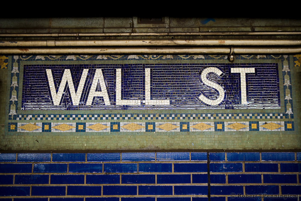Tiled Wall Street subway sign in downtown New York City, NY USA