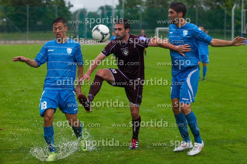 Dragan Ovcina of NK Triglav & Miha Mevlja and Alen Pavic of ND Gorica during football match between NK Triglav Kranj and ND Gorica, 7th Round of Prva Liga, on 26 August, 2012, in Sportni center, Kranj, Slovenia. (Photo by Grega Valancic / Sportida)