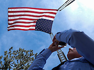 A member of Los Angeles Fire Department takes pictures as a giant U.S. flag flies over the processional route during the funeral of Whittier Police Officer Keith Boyer at Rose Hills Memorial Park in Whittier, Calif., Friday March 3, 2017. Boyer, who was fatally shot after responding to a traffic crash, was remembered today by thousands of law enforcement officers, friends and family as a dedicated public servant, talented drummer, loving friend and even a ``goofy'' dad.(Photo by Ringo Chiu/PHOTOFORMULA.com)<br />