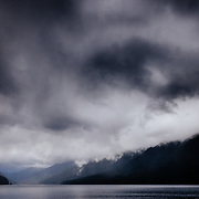 Lake Crescent in Olympic National Park with rain storm and clouds during spring.