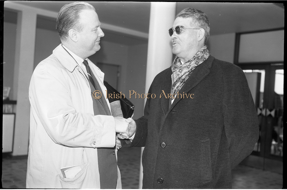 06/02/1964<br /> 02/06/1964<br /> 06 February 1964<br /> Canadian Government Travel Bureau Manager at Dublin Airport. Mr George wilson Powell, of Quebec, European Manager of the Canadian Government Travel Bureau on his first visit to Ireland. Image shows Mr Paul V. McLane (right), Canadian Charge d'Affaires in Dublin, welcoming Mr Powell on his arrival at Dublin Airport.