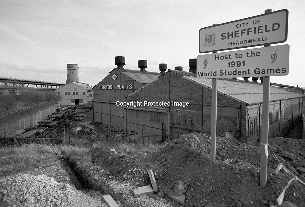 Sign on the outskirts of Sheffield announcing the hosting of the 1991 World Student Games. In the background is George Turton Platts steel founders and the now demolished Blackburn Meadows Power Station cooling towers that was the site of a proposed combined heat and power plant. 5 February 1990
