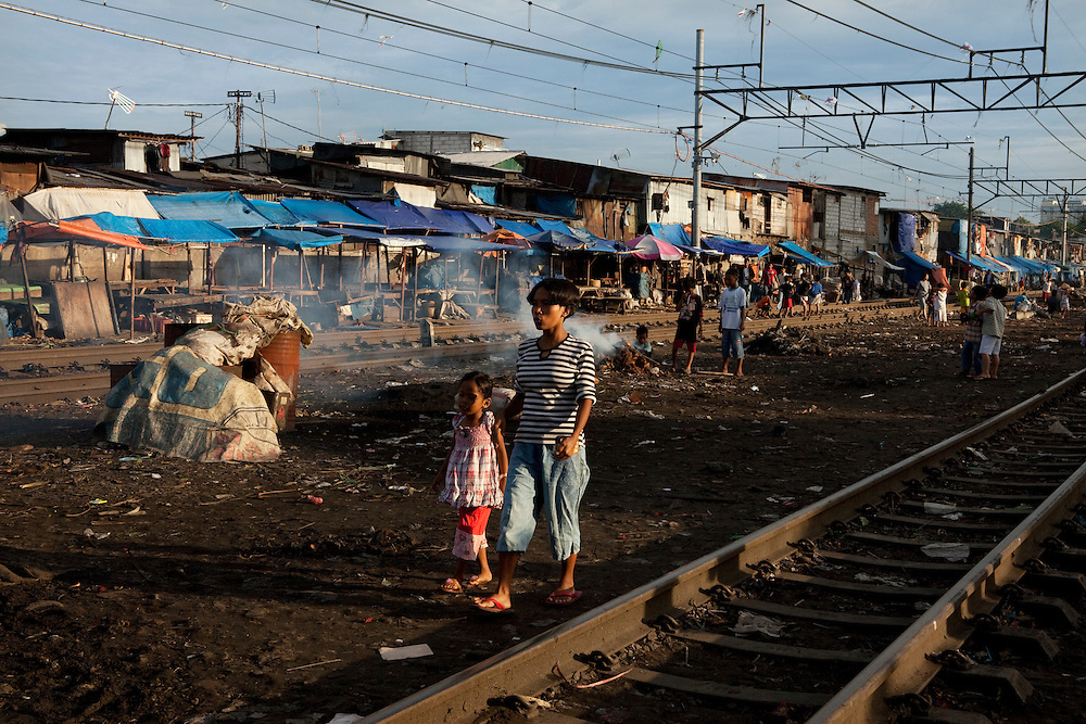 People and a small market on the railway in Tambor, Jakarta, Indonesia.