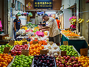 24 AUGUST 2018 - GEORGE TOWN, PENANG, MALAYSIA: A fruit stand across the street from Chowrasta Market in central George Town. Chowrasta Market was originally built in 1890 and is the older of two traditional markets in George Town. The original building was torn down and replaced with a modern building in 1961 and has been renovated several times since.     PHOTO BY JACK KURTZ