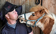 Niblet gets in the face of Chris Richards after tending to his hooves back in April at Cedar Ridge Equestrian Center north of Renner. Richards is a Farrier based out of Hurley serving clients in a 50 mile radius. (Matt Gade/Republic)