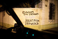 """Graffiti that reads: We live without drugs. Liar. Drug Addicts,"""" in zona 1, Guatemala City, Guatemala, on Thursday, Nov. 3, 2011."""