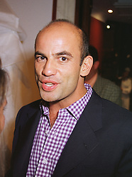 MR GUY DELLAL a friend of model Jerry Hall, at a party in London on 22nd June 1999.MTP 17